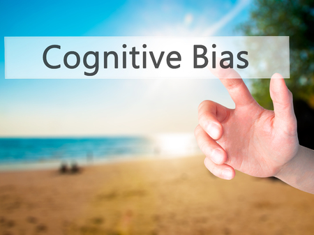 bias: Cognitive Bias - Hand pressing a button on blurred background concept . Business, technology, internet concept. Stock Photo Stock Photo