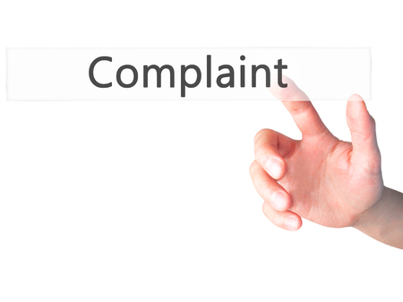 customer records: Complaint - Hand pressing a button on blurred background concept . Business, technology, internet concept. Stock Photo