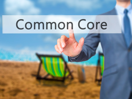 repeal: Common Core - Businessman click on virtual touchscreen. Business and IT concept. Stock Photo