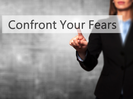 confront: Confront Your Fears -  Successful businesswoman making use of innovative technologies and finger pressing button. Business, future and technology concept. Stock Photo