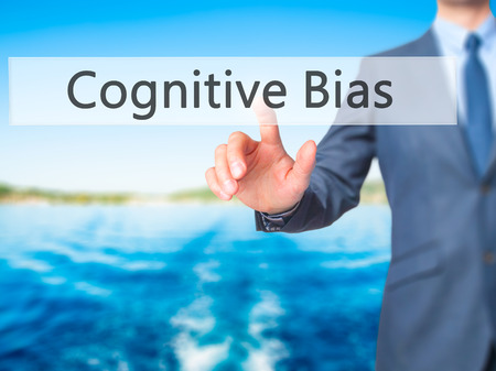 cognitive: Cognitive Bias - Businessman click on virtual touchscreen. Business and IT concept. Stock Photo