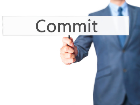 comit� d entreprise: Commit - Business man showing sign. Business, technology, internet concept. Stock Photo