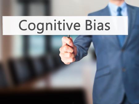 plea: Cognitive Bias - Business man showing sign. Business, technology, internet concept. Stock Photo