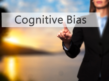cognitive: Cognitive Bias -  Successful businesswoman making use of innovative technologies and finger pressing button. Business, future and technology concept. Stock Photo Stock Photo