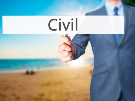 corrupt practice: Civil - Businessman hand holding sign. Business, technology, internet concept. Stock Photo Stock Photo