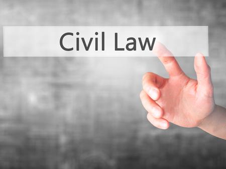 Diritto civile - Stampaggio a mano un tasto su sfondo sfocato concetto. Affari, tecnologia, il concetto di internet. Archivi fotografici
