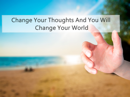 leadership potential: Change Your Thoughts And You Will Change Your World - Hand pressing a button on blurred background concept . Business, technology, internet concept. Stock Photo Stock Photo