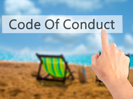 principles: Code Of Conduct - Hand pressing a button on blurred background concept . Business, technology, internet concept. Stock Photo Stock Photo