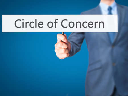 persuaded: Circle of Concern - Businessman hand holding sign. Business, technology, internet concept. Stock Photo Stock Photo