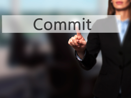 comit� d entreprise: Commit -  Successful businesswoman making use of innovative technologies and finger pressing button. Business, future and technology concept. Stock Photo Banque d'images