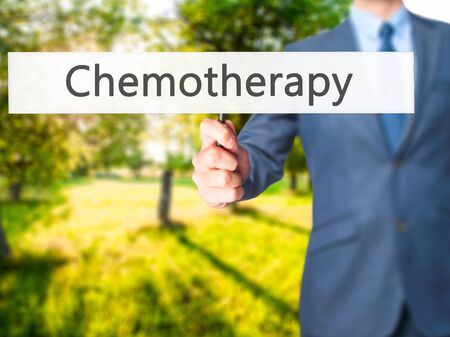 Chemotherapy - Businessman hand holding sign. Business, technology, internet concept. Stock Photo
