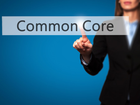 repeal: Common Core -  Successful businesswoman making use of innovative technologies and finger pressing button. Business, future and technology concept. Stock Photo