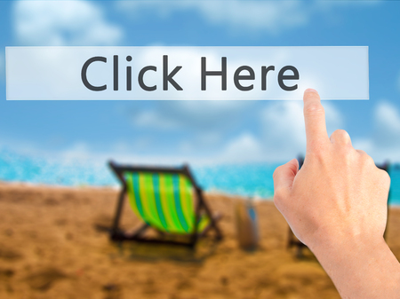 Click Here - Hand pressing a button on blurred background concept . Business, technology, internet concept. Stock Photo