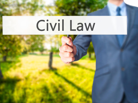 Civil Law - Businessman hand holding sign. Business, technology, internet concept. Stock Photo