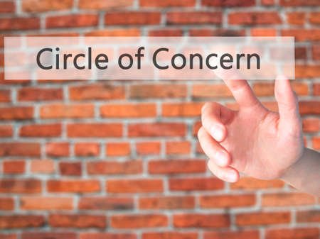 persuade: Circle of Concern - Hand pressing a button on blurred background concept . Business, technology, internet concept. Stock Photo