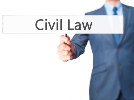 obligations: Civil Law - Businessman hand holding sign. Business, technology, internet concept. Stock Photo