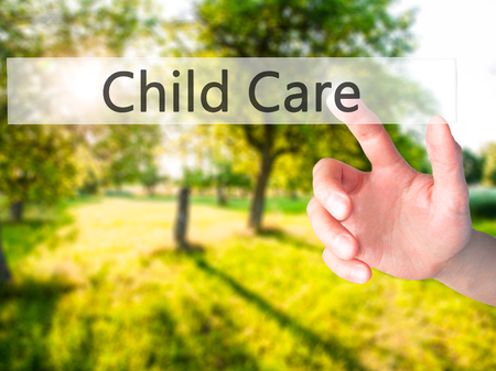 guidepost: Child Care - Hand pressing a button on blurred background concept . Business, technology, internet concept. Stock Photo
