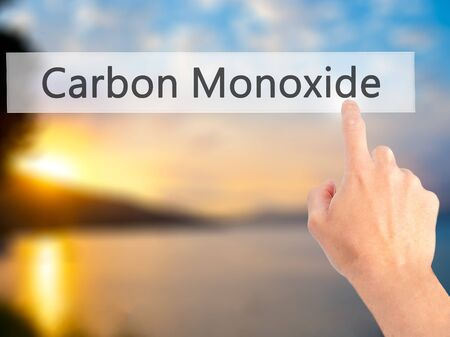 carbon monoxide: Carbon Monoxide - Hand pressing a button on blurred background concept . Business, technology, internet concept. Stock Photo Stock Photo