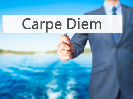 carpe diem: Carpe Diem - Business man showing sign. Business, technology, internet concept. Stock Photo Stock Photo