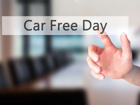 polution: Car Free Day - Hand pressing a button on blurred background concept . Business, technology, internet concept. Stock Photo