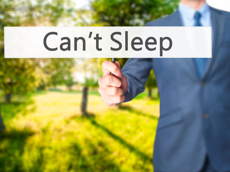 Cant Sleep - Business man showing sign. Business, technology, internet concept. Stock Photo Stock Photo