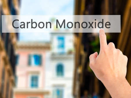 vapour: Carbon Monoxide - Hand pressing a button on blurred background concept . Business, technology, internet concept. Stock Photo Stock Photo