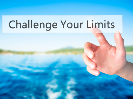 persistence: Challenge Your Limits - Hand pressing a button on blurred background concept . Business, technology, internet concept. Stock Photo