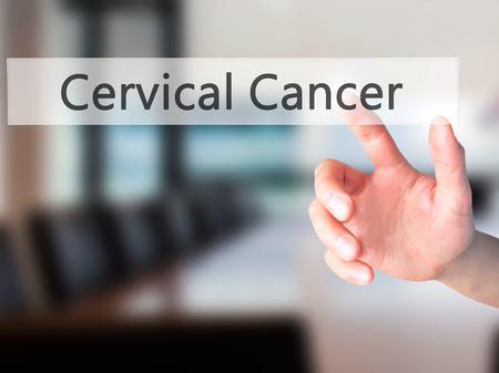 cervix: Cervical Cancer - Hand pressing a button on blurred background concept . Business, technology, internet concept. Stock Photo