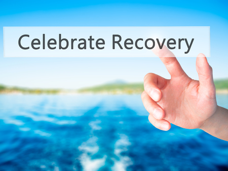 Celebrate Recovery - Hand pressing a button on blurred background concept . Business, technology, internet concept. Stock Photo