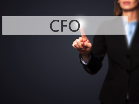 cfo: CFO (Chief Financial Officer) - Isolated female hand touching or pointing to button. Business and future technology concept. Stock Photo Stock Photo