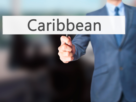 caribe: Caribbean - Business man showing sign. Business, technology, internet concept. Stock Photo