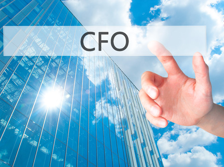 comité d entreprise: CFO (Chief Financial Officer) - Hand pressing a button on blurred background concept . Business, technology, internet concept. Stock Photo