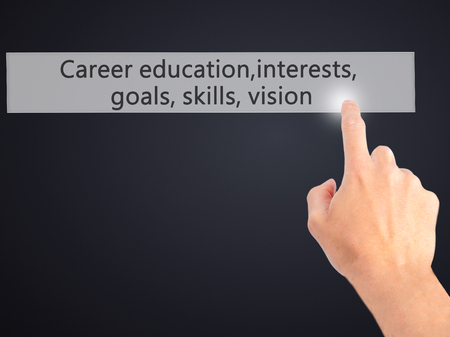 blurred vision: Career education, interests, goals, skills, vision - Hand pressing a button on blurred background concept . Business, technology, internet concept. Stock Photo