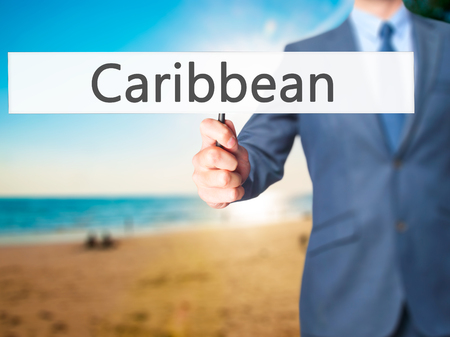 port au prince: Caribbean - Business man showing sign. Business, technology, internet concept. Stock Photo