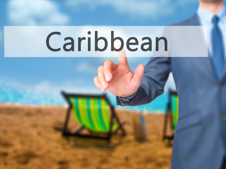 Caribbean - Businessman press on digital screen. Business,  internet concept. Stock Photo Stock Photo