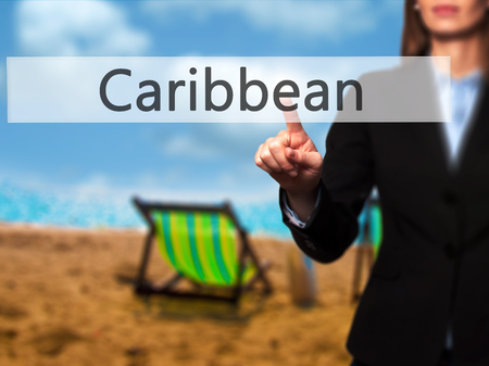 caribe: Caribbean - Isolated female hand touching or pointing to button. Business and future technology concept. Stock Photo Stock Photo