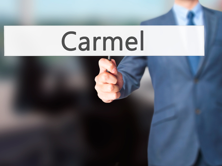 carmel: Carmel - Business man showing sign. Business, technology, internet concept. Stock Photo
