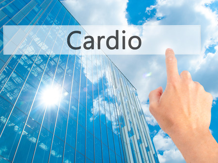 Cardio - Hand pressing a button on blurred background concept . Business, technology, internet concept. Stock Photo