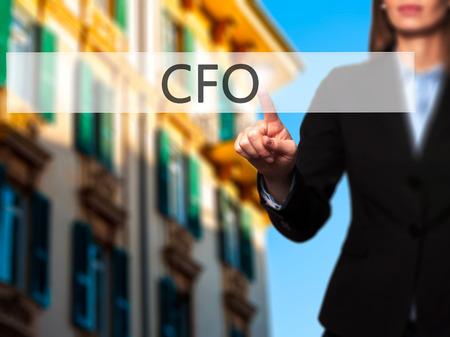 comité d entreprise: CFO (Chief Financial Officer) - Isolated toucher main féminine ou pointant vers le bouton. Affaires et futur concept technologique. photo Banque d'images