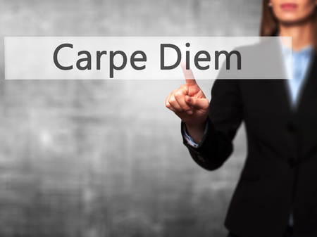 carpe diem: Carpe Diem - Isolated female hand touching or pointing to button. Business and future technology concept. Stock Photo