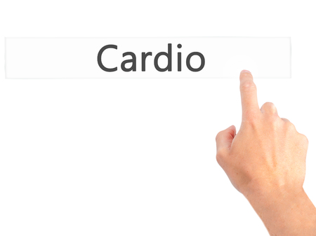signos vitales: Cardio - Hand pressing a button on blurred background concept . Business, technology, internet concept. Stock Photo