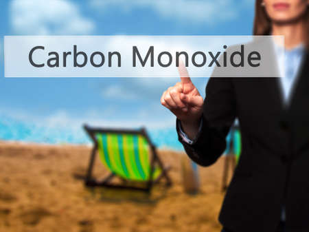 monoxide: Carbon Monoxide - Isolated female hand touching or pointing to button. Business and future technology concept. Stock Photo Stock Photo