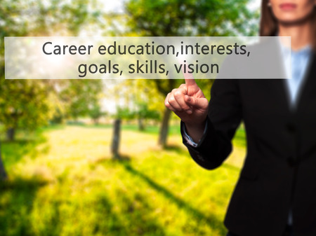 Career education, interests, goals, skills, vision - Isolated female hand touching or pointing to button. Business and future technology concept. Stock Photo