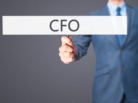 comité d entreprise: CFO (Chief Financial Officer) - Business man showing sign. Business, technology, internet concept. Stock Photo