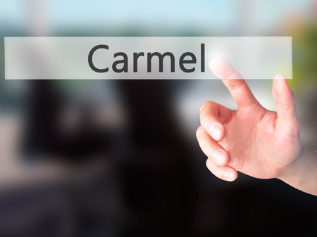 carmel: Carmel - Hand pressing a button on blurred background concept . Business, technology, internet concept. Stock Photo Stock Photo