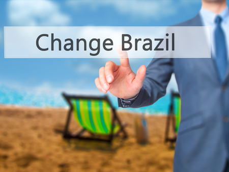 protestors: Change Brazil - Businessman press on digital screen. Business,  internet concept. Stock Photo