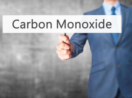poisonous substances: Carbon Monoxide - Business man showing sign. Business, technology, internet concept. Stock Photo