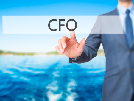 chief executive officer: CFO (Chief Financial Officer) - Businessman press on digital screen. Business,  internet concept. Stock Photo