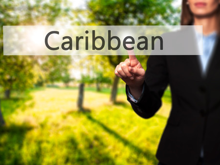 Caribbean - Isolated female hand touching or pointing to button. Business and future technology concept. Stock Photo Stock Photo
