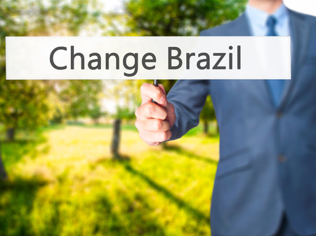 Change Brazil - Business man showing sign. Business, technology, internet concept. Stock Photo